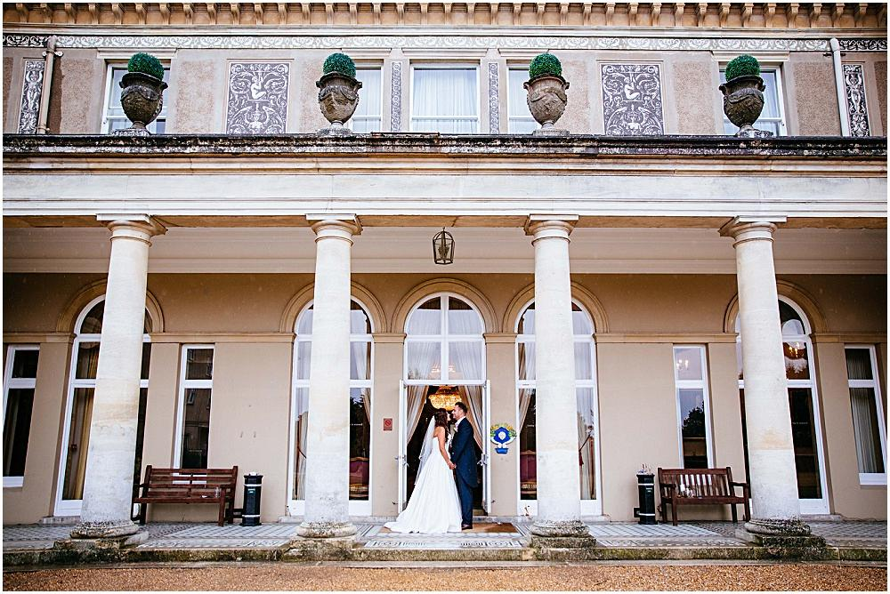 Rainy wedding couple photographs at Down Hall hotel