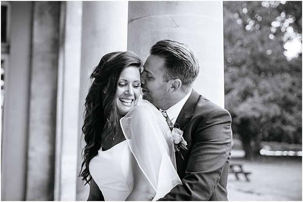 Groom kissing the bride at Down Hall