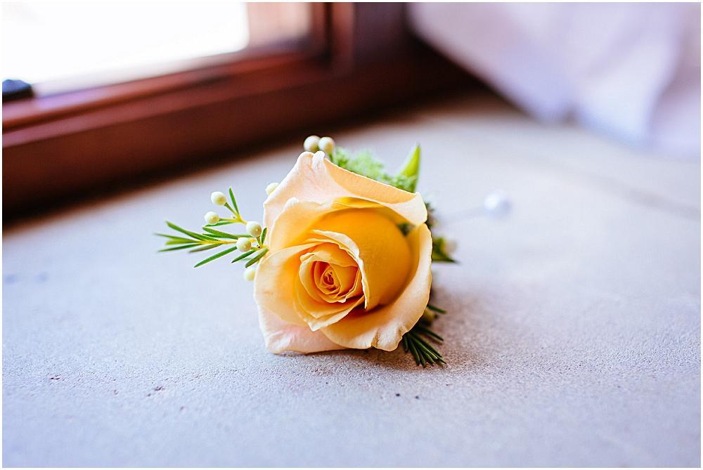 Orange rose button hole