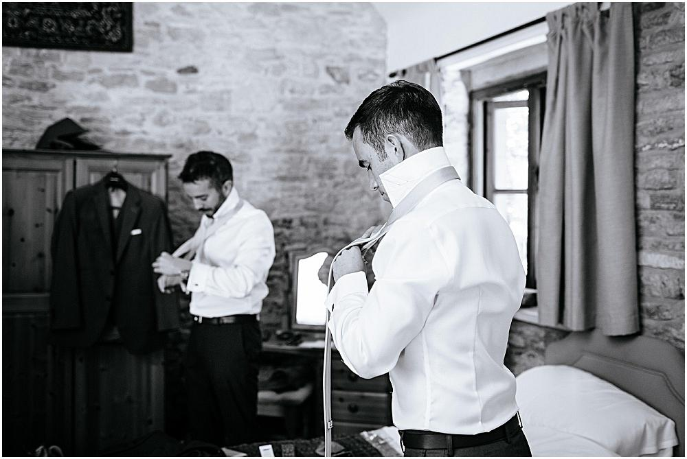 Ushers putting ties on