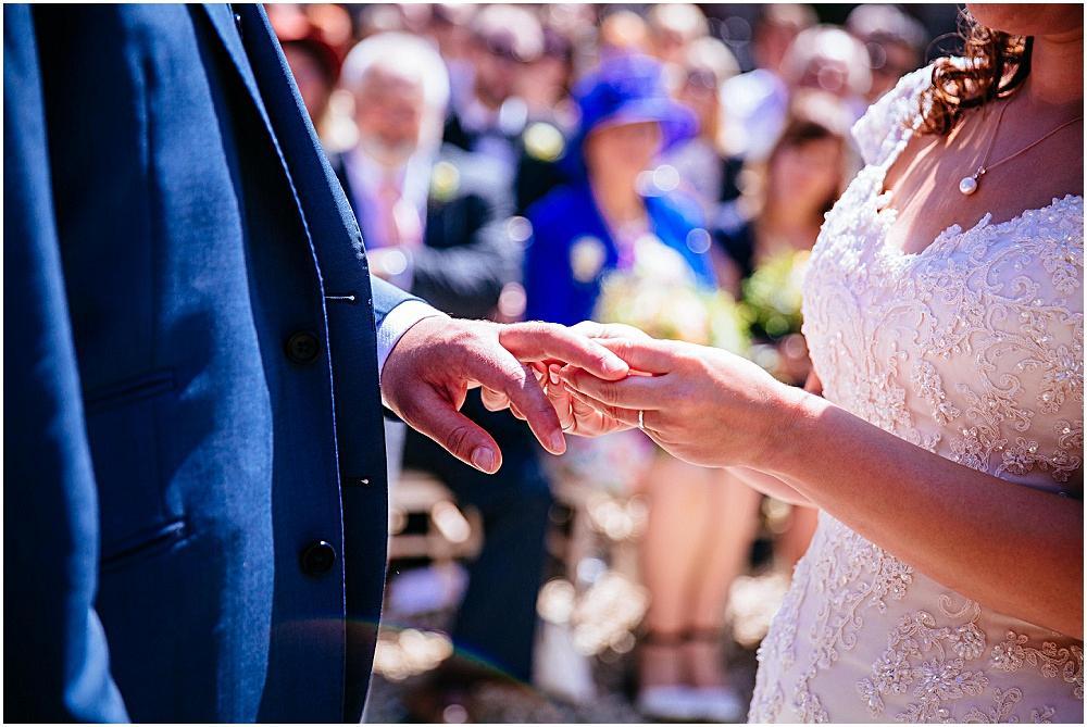 Exchange of rings at dorset wedding