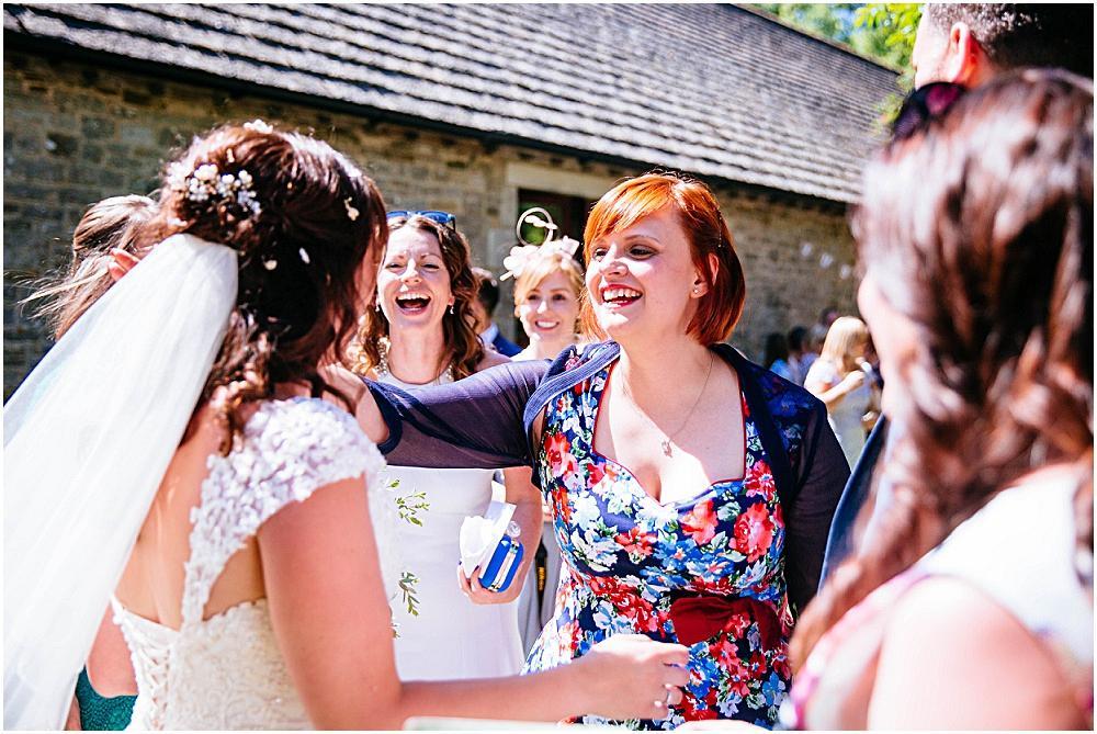 Happy guests greeting bride