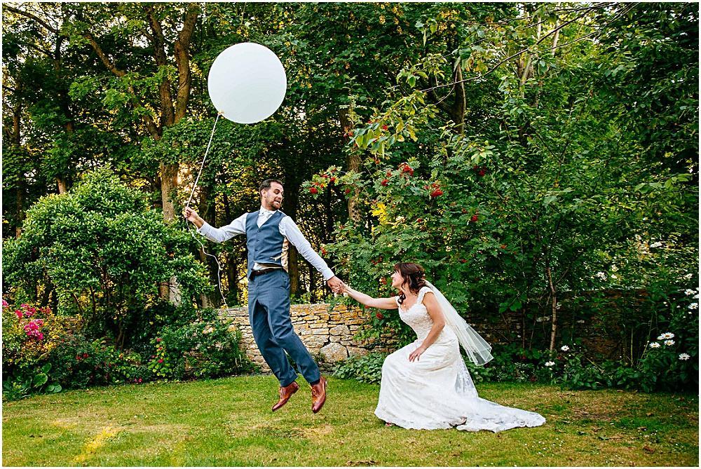 Creative wedding photography with big balloon