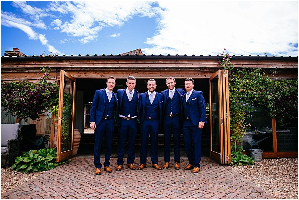 Groom and ushers outside pheasantry