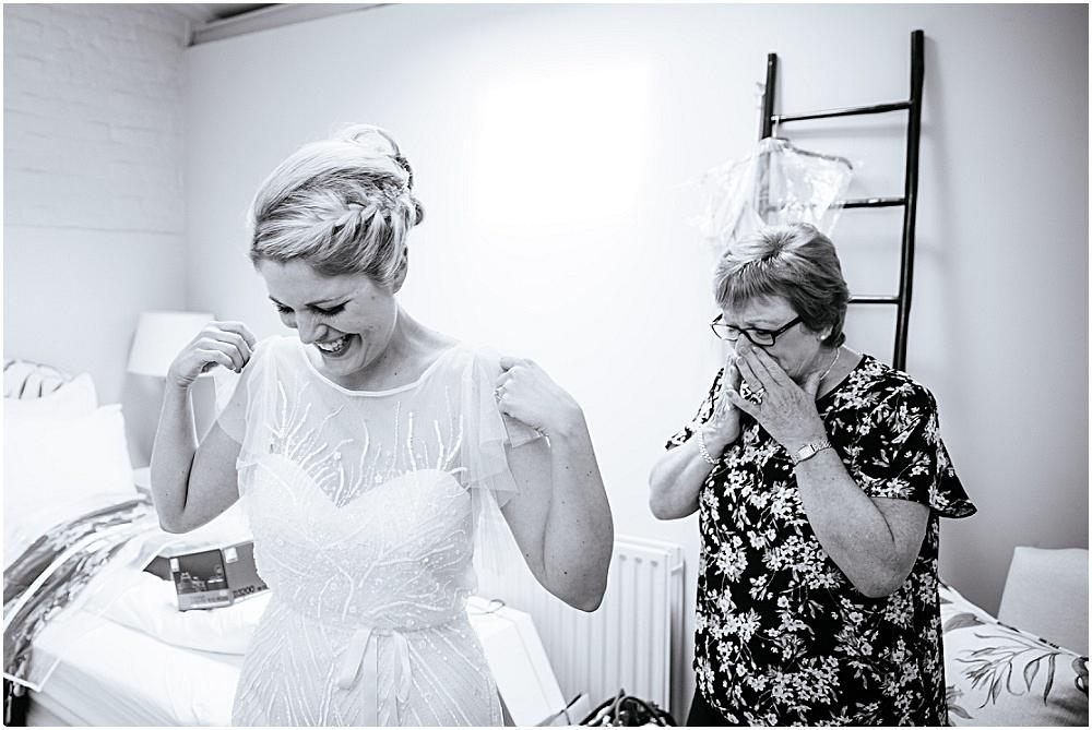 Mum gasps as she sees bride in dress