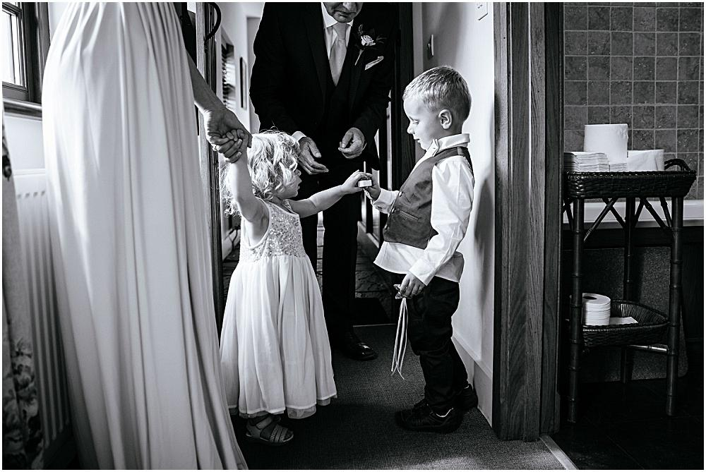 Little girl gives ring to pageboy