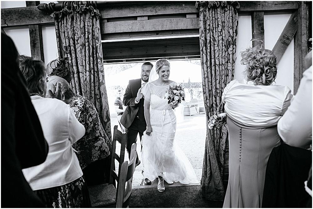 Bride and groom entering their wedding breakfast