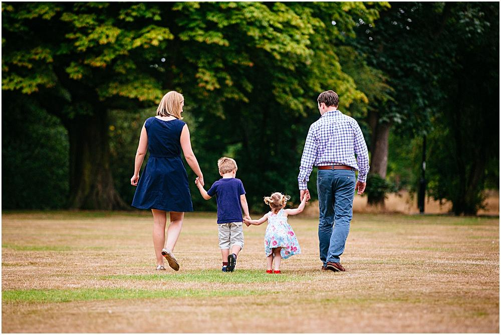 Happy family walking on Wandsworth Common