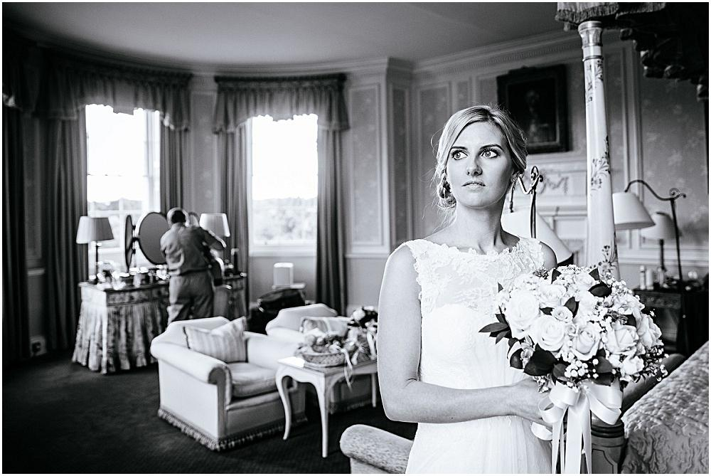 Stunning hertfordshire wedding bride looks out of window