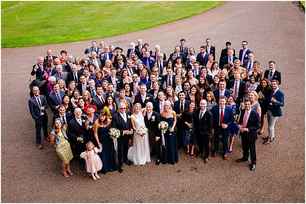 All wedding guests photographed from upstairs window