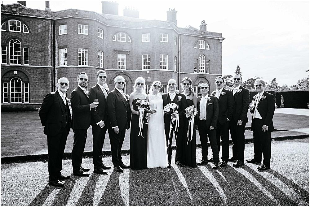 Wedding party and their shadow at Brocket Hall wedding
