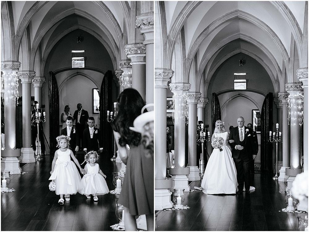 Bride and father walk down wotton house aisle