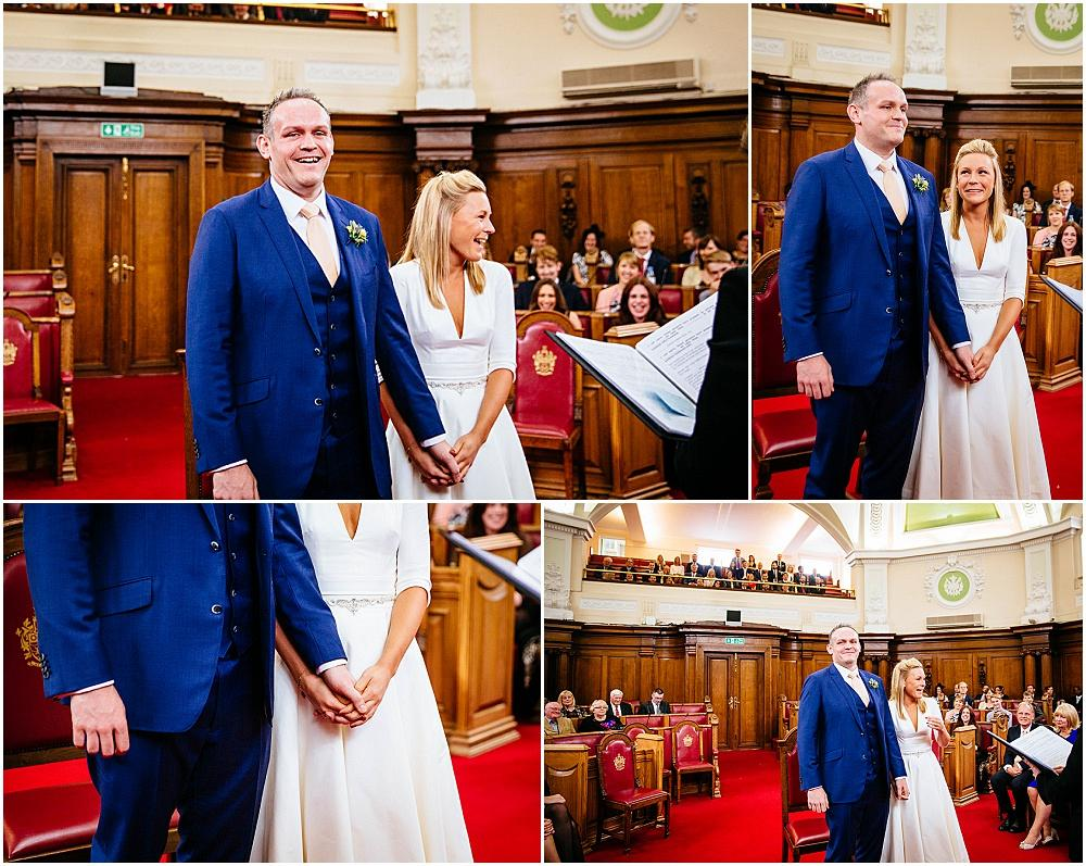 Bride and groom laughing during islington town hall wedding