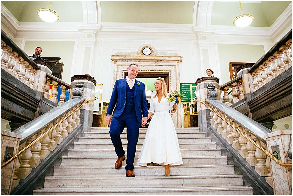 Bride and groom on islington town hall steps