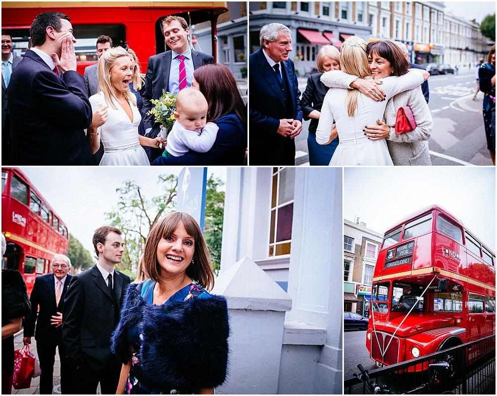 Wedding guests and big red london bus