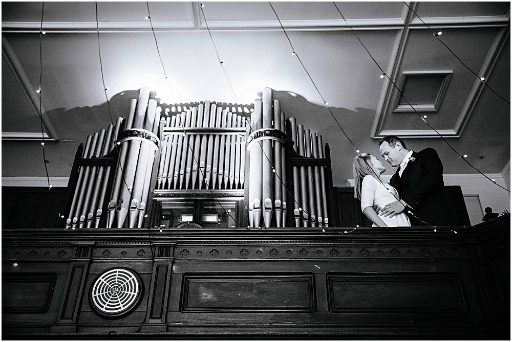 Bride and groom and large organ