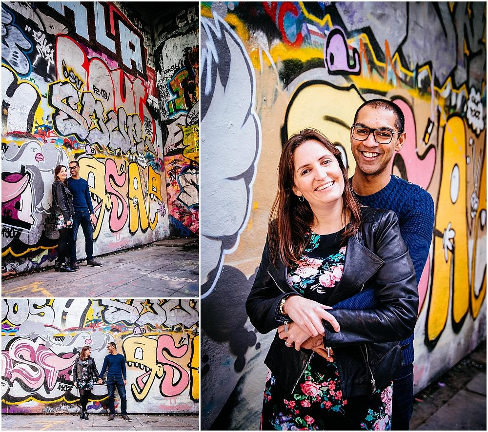 Couple photography in front of grafitti on southbank waterloo