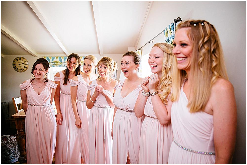 Bridesmaids gasping at gate street barn wedding