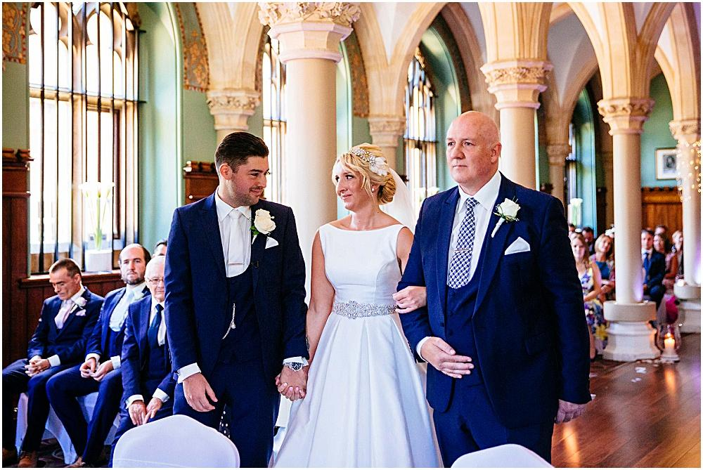 Bride and groom and dad