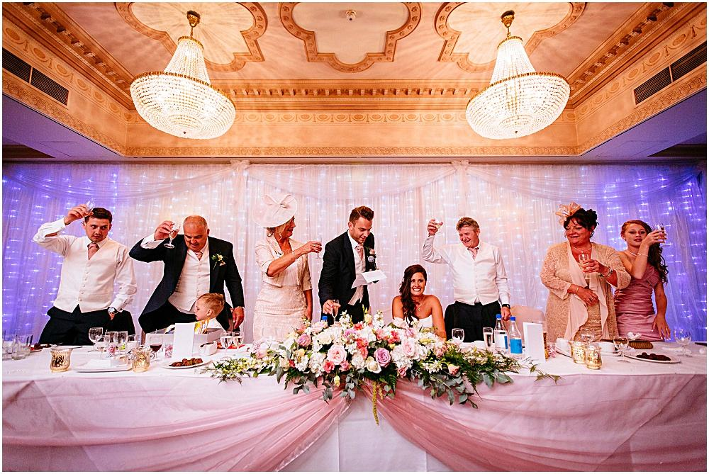 Toasting the bride during wedding speeches