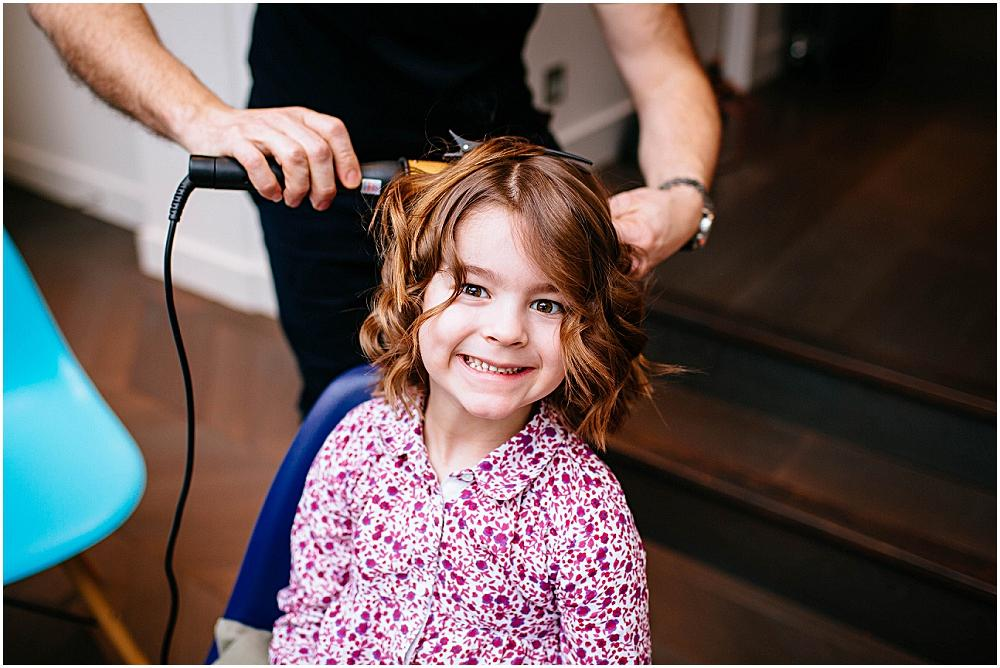 Flower girl having hair curled in london