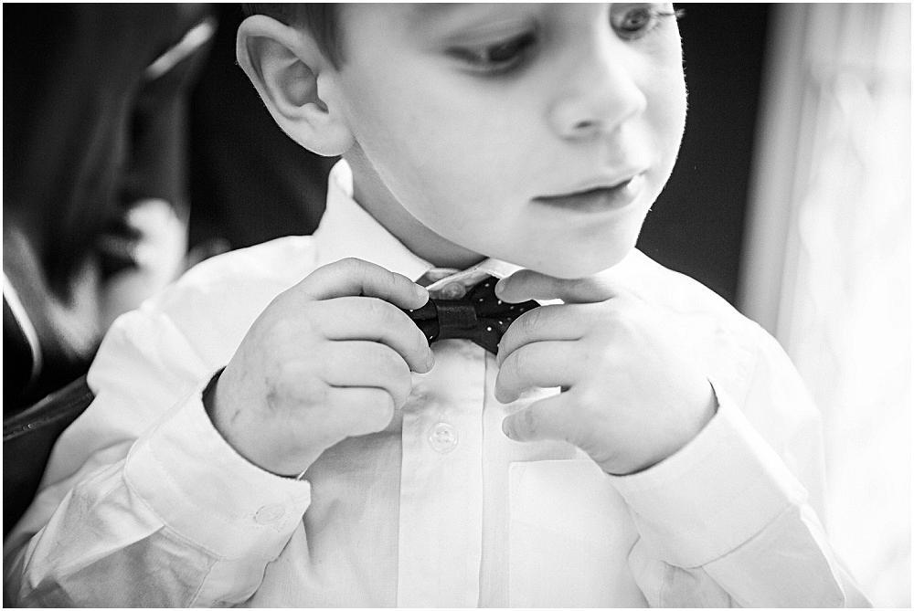 Son of bride adjusts bow tie