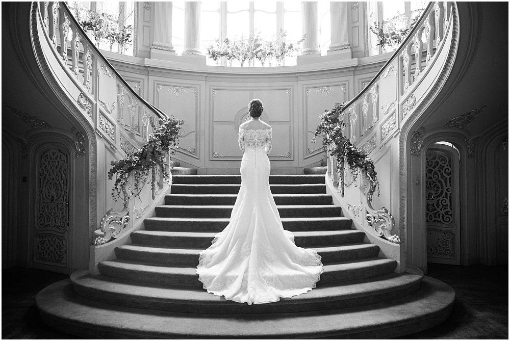 Back of brides dress on savile club stairs