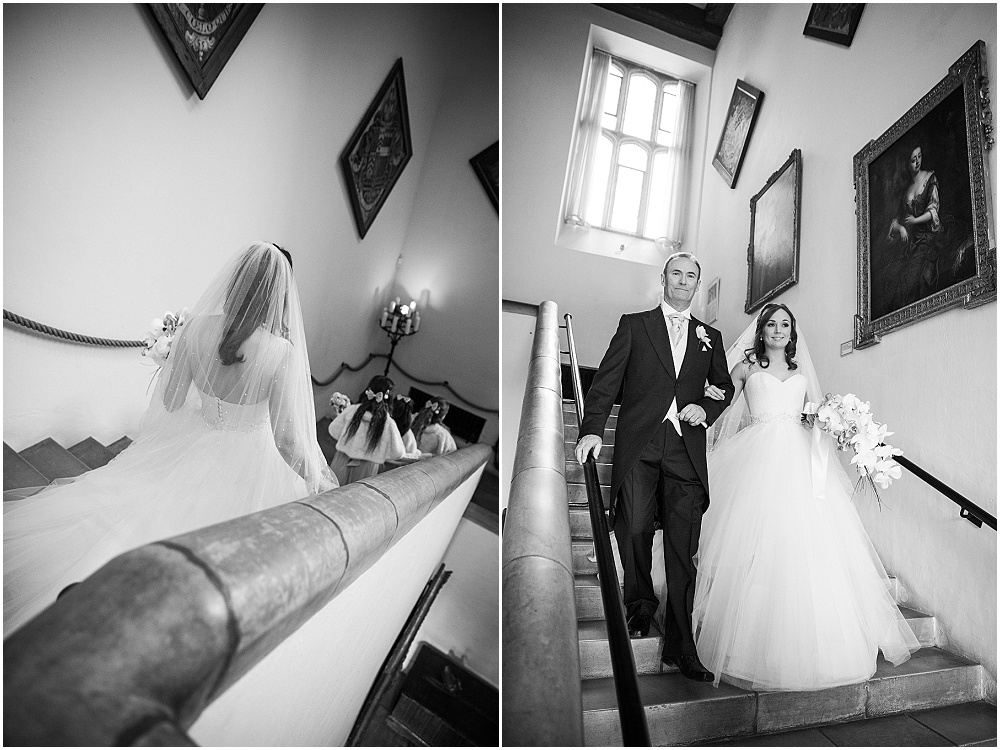 Bride and father on staircase