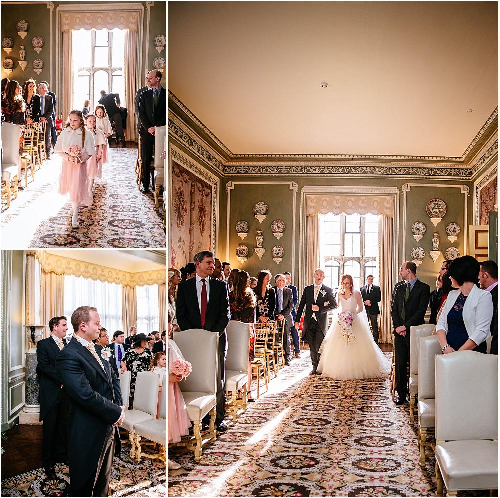 Bride walks down aisle in leeds castle wedding