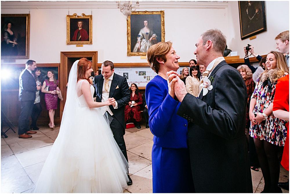 Parents of bride dance together at wedding