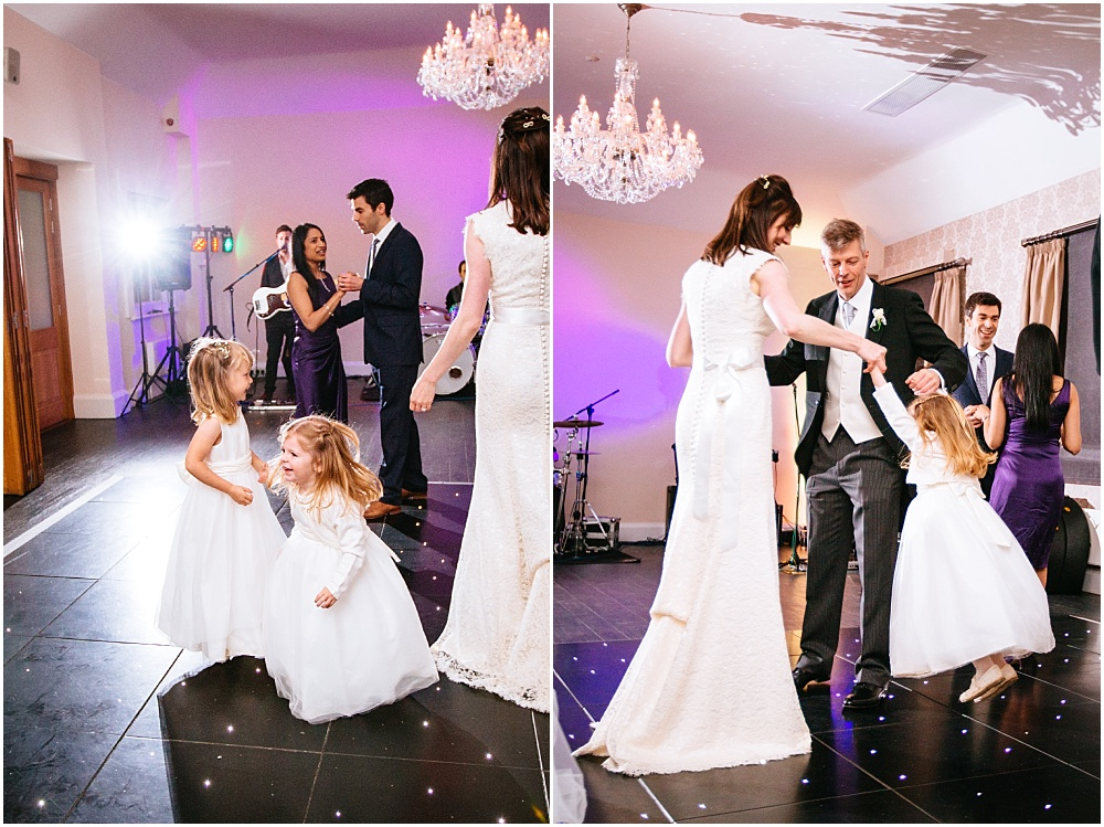 Bride and groom dancing with daughter