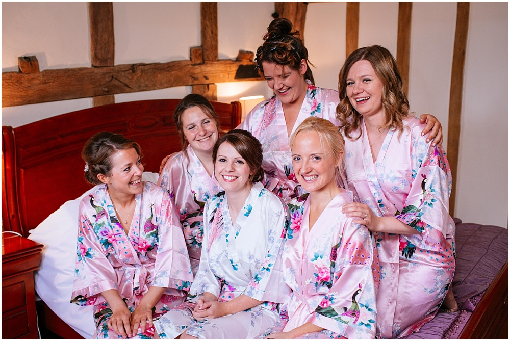 Bridesmaids in floral pink dressing gowns