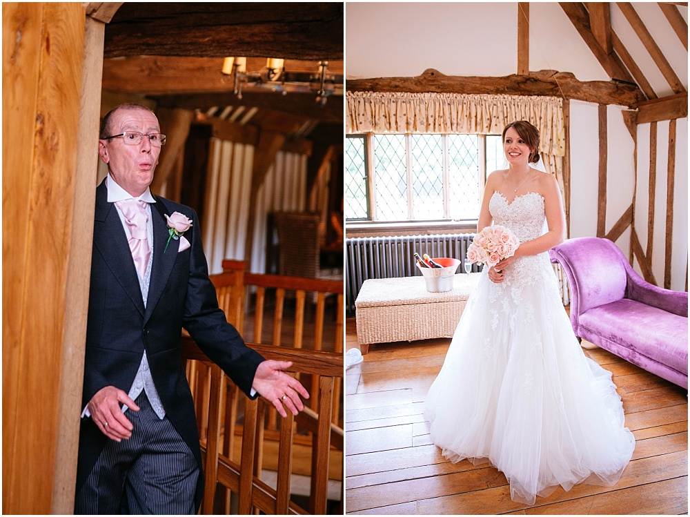 Father of bride gasps at bride in her wedding dress