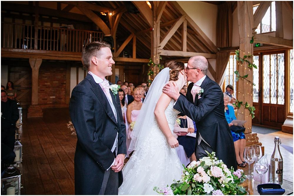 Father kisses bride