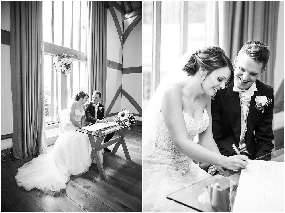 Mocked up signing the register at a Surrey wedding