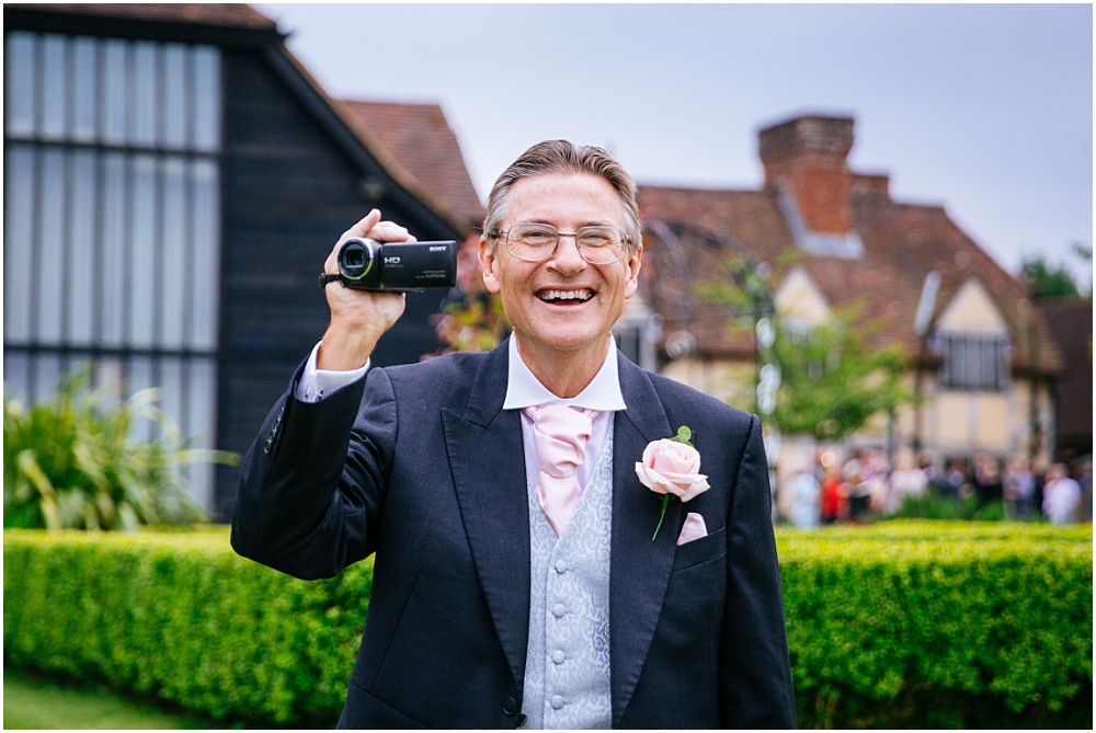 Laughing father with camera
