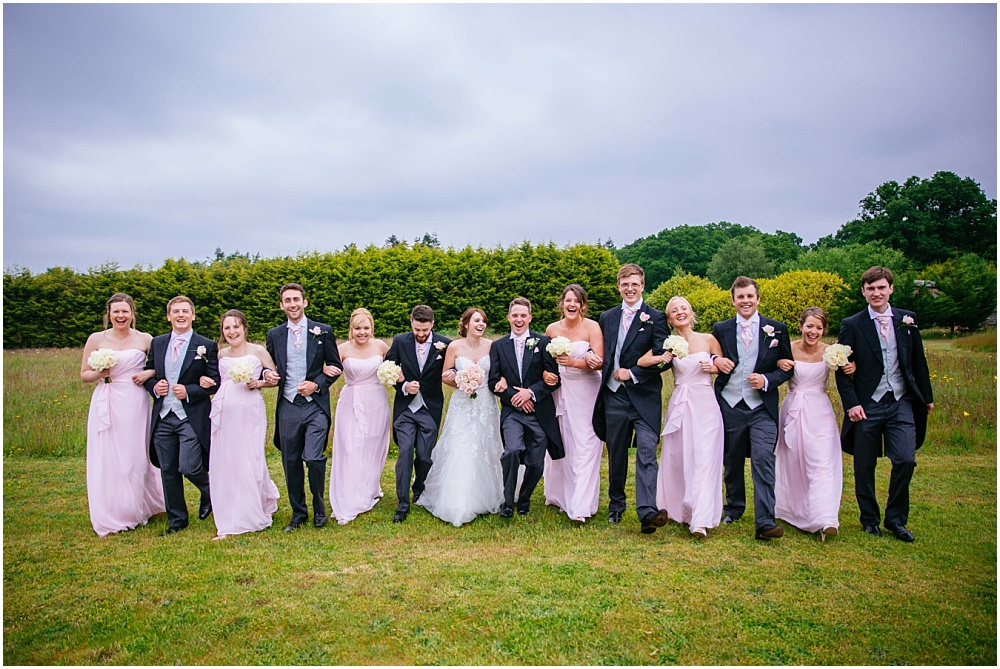 Bridesmaids and ushers photograph in cain manor garden