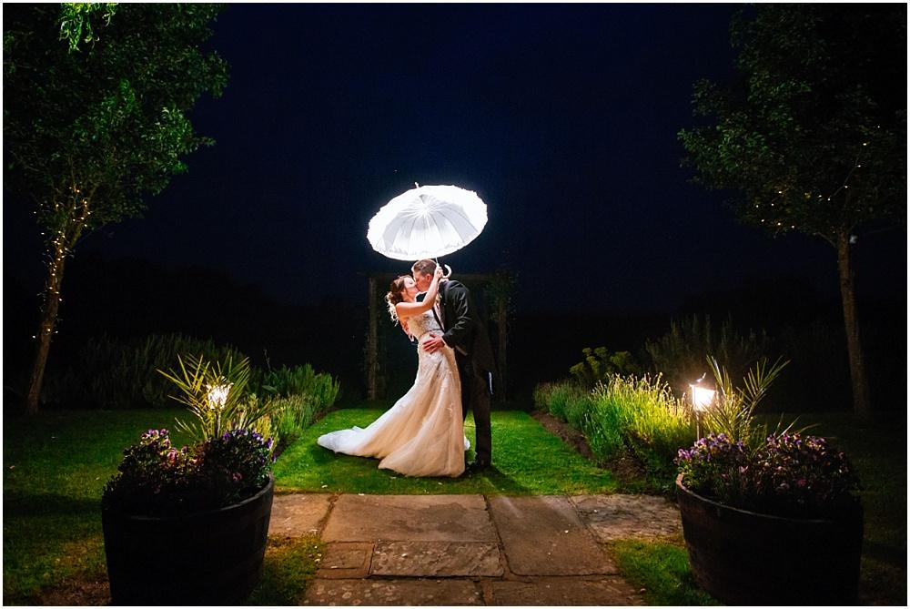 Backlit umbrella wedding photograph