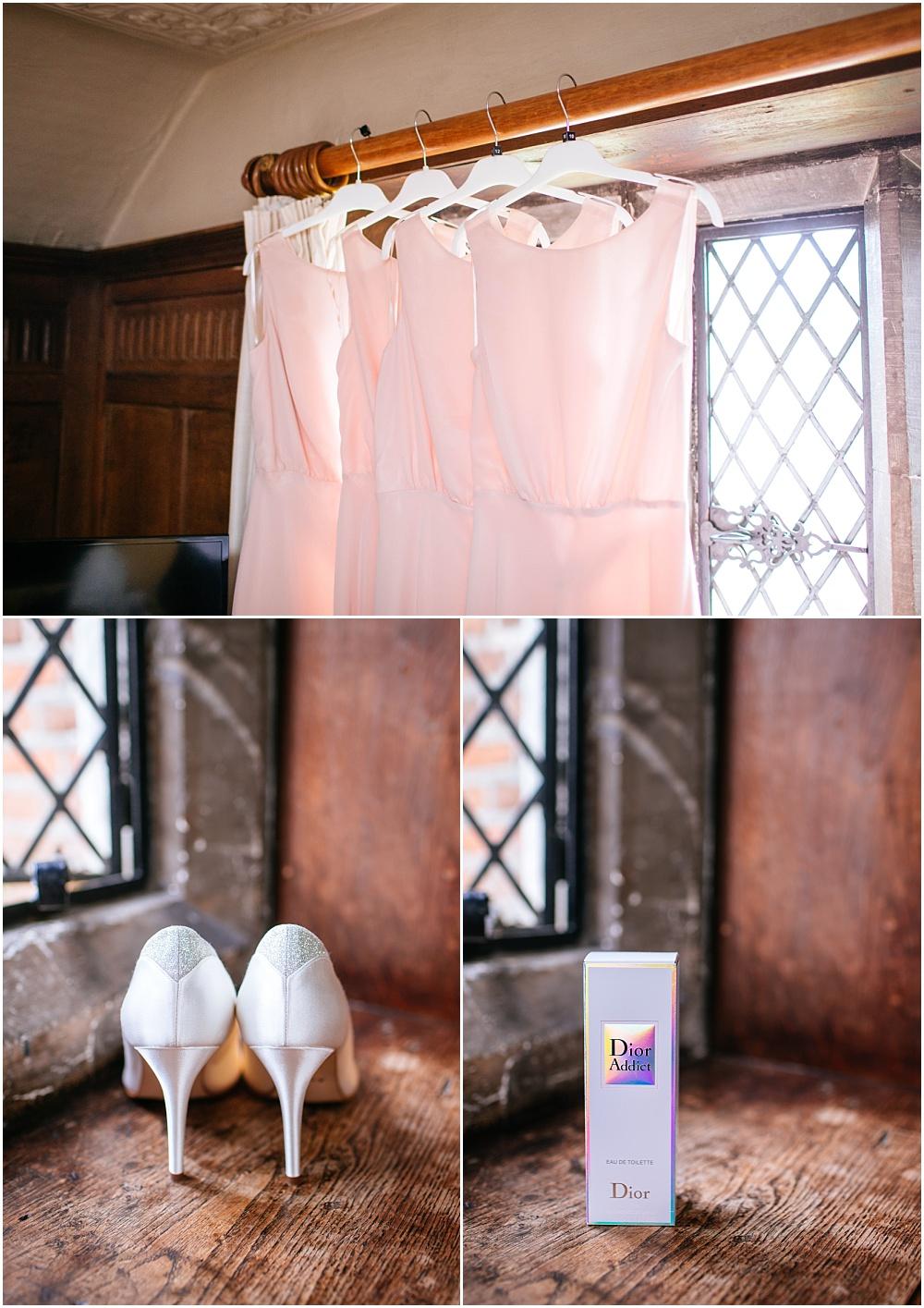 Pink bridesmaids dresses hanging up