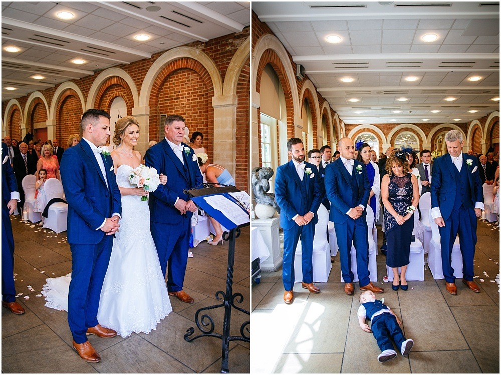 pageboy lies on floor during wedding ceremony