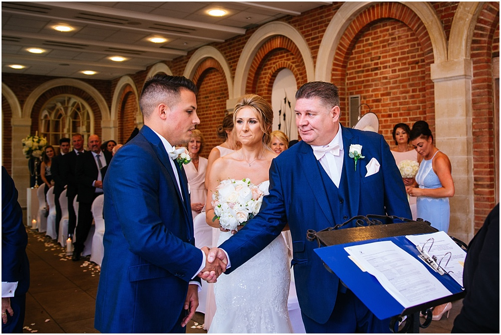Shaking hands with the groom