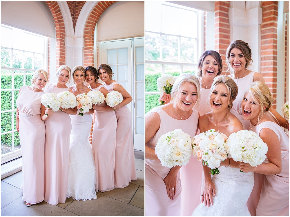 Happy bridesmaids in pink long dresses