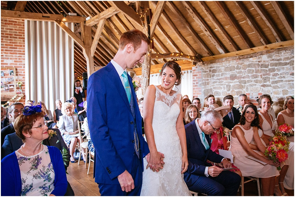 Laughter during grittenham barn wedding