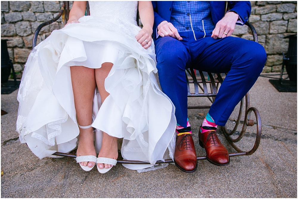 Wedding couple on rocking bench with shoes