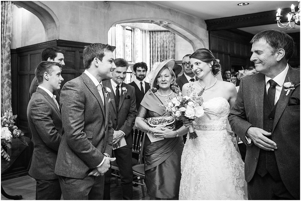 Bride walks down the aisle in lanwades hall