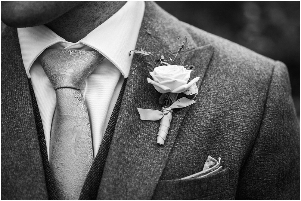 Tweed wedding suit and rose button hole