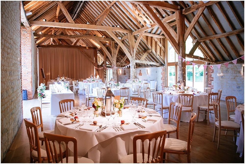Barn at bury court set up for wedding breakfast