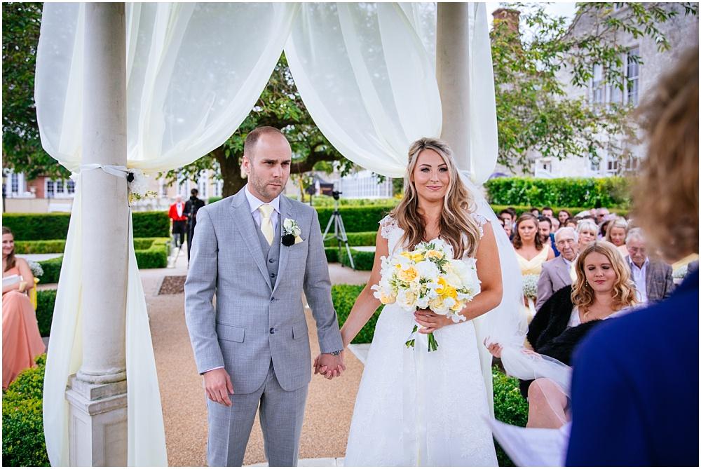 Bride and groom during outdoor wedding ceremony alton froyle