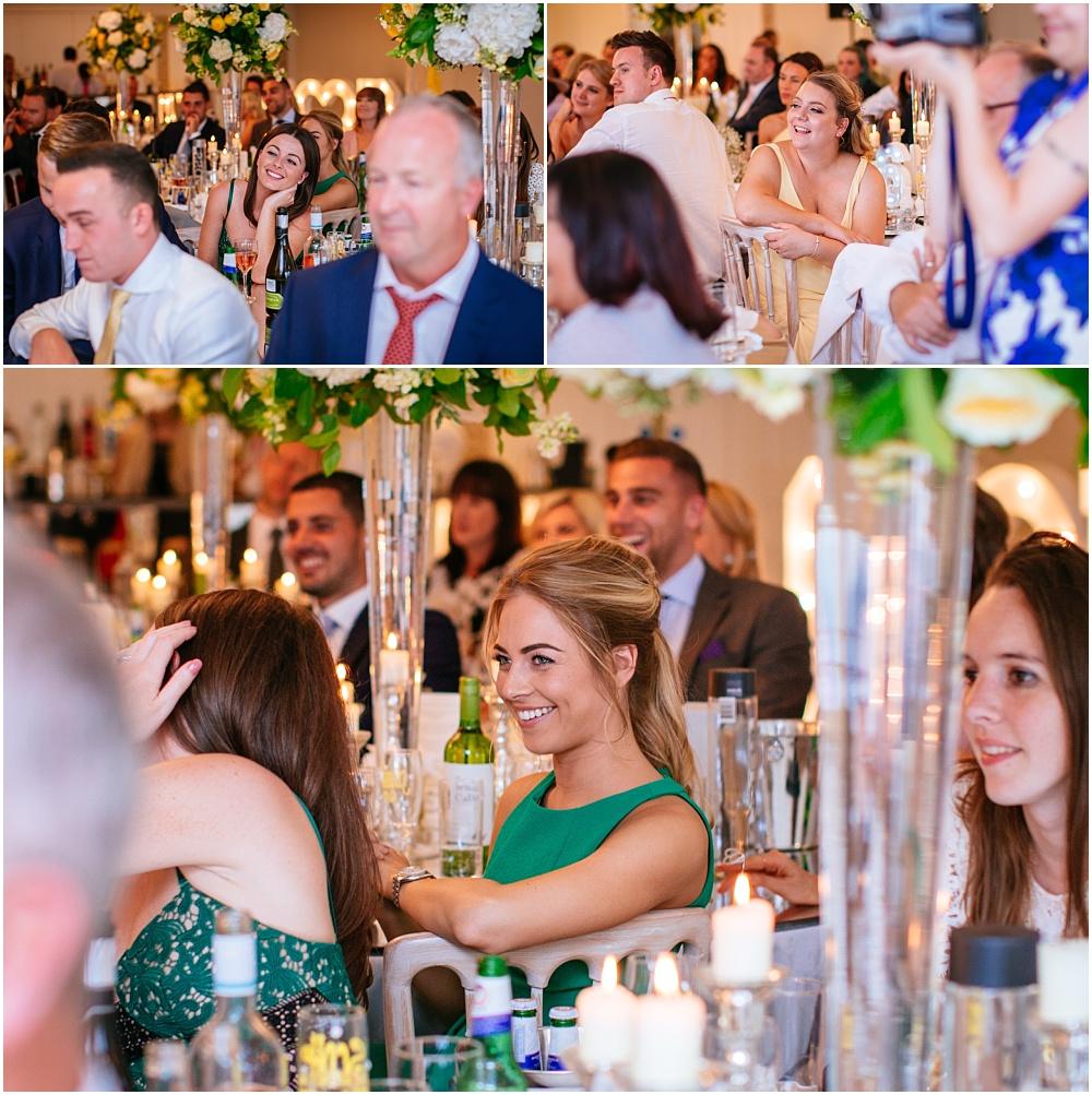 Guests listen to wedding speeches