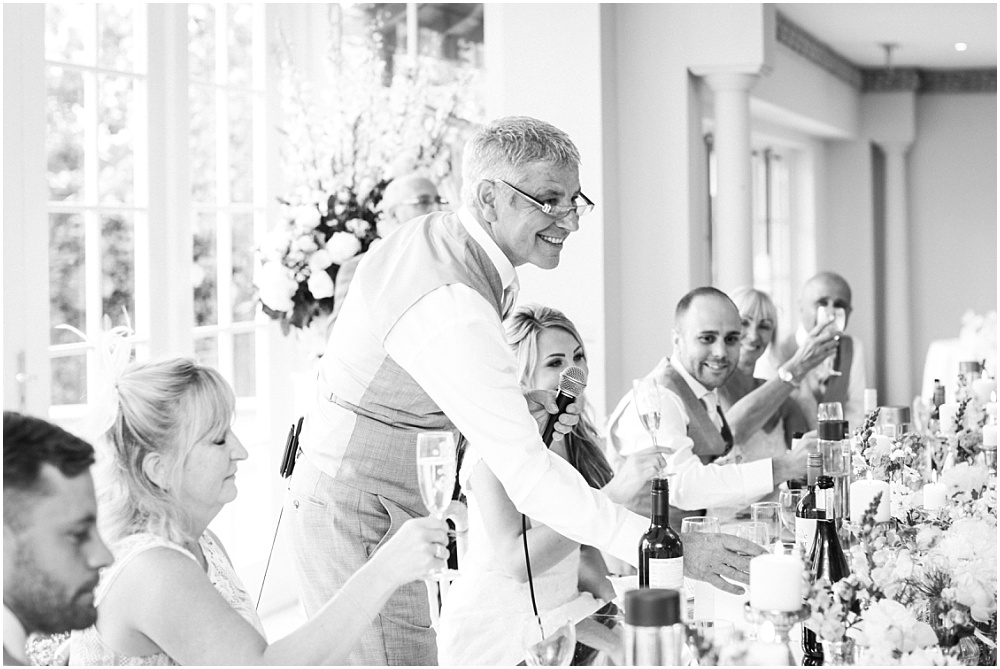 Smiling father of the bride during speech